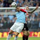 Sunderland's Adam Johnson, right, vies for the ball with Manchester City's Aleksander Kolarov, during their English League Cup final soccer match at Wembley Stadium, London, England, Sunday, March 2, 2014