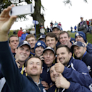 Europe's Graeme McDowell takes a selfie with a group of green keepers after putting out on the 4th green during a practice round ahead of the Ryder Cup golf tournament, at Gleneagles, Scotland, Tuesday, Sept. 23, 2014. (AP Photo/Matt Dunham)