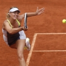 Russia's Maria Sharapova returns the ball to  Belarus' Victoria Azarenka during their semifinal match of the French Open tennis tournament at the Roland Garros stadium Thursday, June 6, 2013 in Paris. (AP Photo/Christophe Ena)