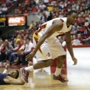Iowa State forward Melvin Ejim, right, runs down a loose ball ahead of Yale guard Armani Cotton during the first half of an NCAA college basketball game, Tuesday, Jan. 1, 2013, in Ames, Iowa. (AP Photo/Charlie Neibergall)