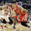 Houston Rockets guard Jeremy Lin (7) drives to the basket as Chicago Bulls guard D.J. Augustin (14) guards during the first half of an NBA basketball game in Chicago on Thursday, March 13, 2014. (AP Photo/Nam Y. Huh)
