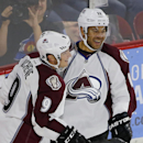 In this Sept. 21, 2014, file photo, Colorado Avalanche's Jarome Iginla (12) celebrates a goal with Matt Duchene (9) during the team's Burgundy and White intrasquad scrimmage in Denver. With the NHL right in the heart of its small preseason slate, a long l
