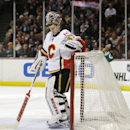 Calgary Flames goalie Joni Ortio, of Finland, stands in front his net after giving up the fourth goal to the Anaheim Ducks, during the second period of an NHL hockey game Wednesday, Jan. 21, 2015, in Anaheim, Calif The Associated Press