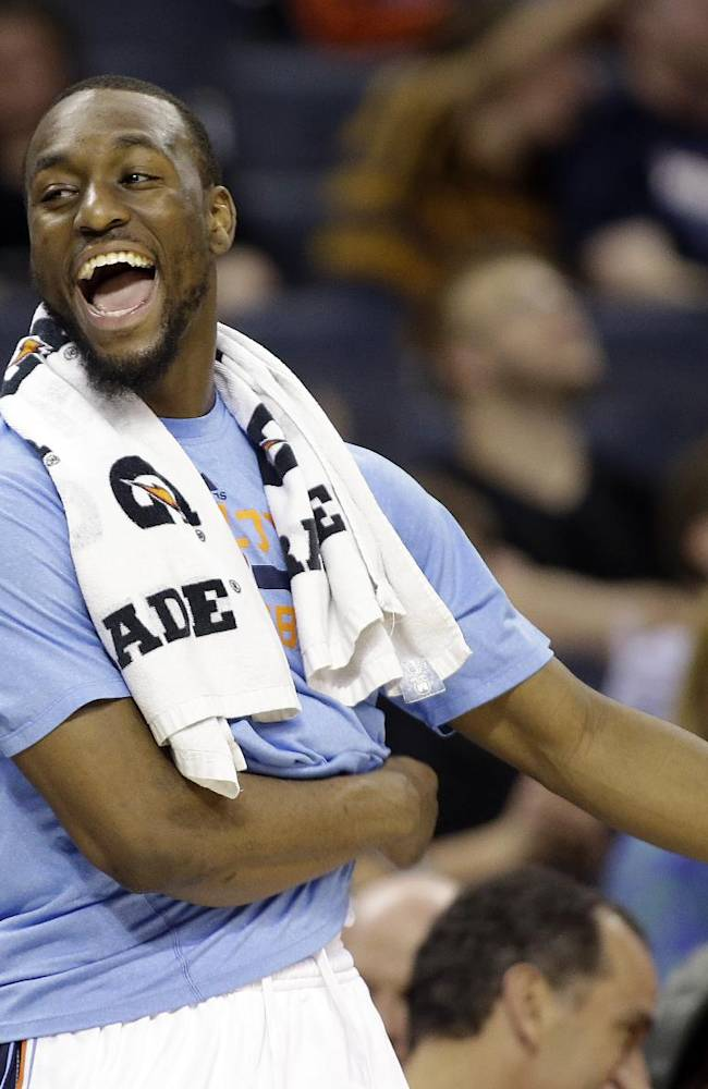 Charlotte Bobcats' Kemba Walker celebrates on the sidelines in the Bobcats' 124-94 win over the Portland Trail Blazers in an NBA basketball game in Charlotte, N.C., Saturday, March 22, 2014