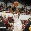 Stanford guard Amber Orrange (33) puts up a 3-point shot against Long Beach State during the first half of an NCAA college basketball game in Stanford, Calif., Sunday, Nov. 25, 2012. (AP Photo/Tony Avelar)