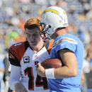 Cincinnati Bengals quarterback Andy Dalton, left, and San Diego Chargers quarterback Philip Rivers talk before an NFL football game on Sunday, Dec. 1, 2013, in San Diego The Associated Press