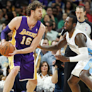 Los Angeles Lakers forward Pau Gasol, left, of Spain, works the ball inside against Denver Nuggets forward J.J. Hickson in the third quarter of the Nuggets' 111-99 victory in an NBA basketball game in Denver on Wednesday, Nov. 13, 2013 The Associated Pres
