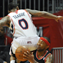 Atlanta Hawks' Jeff Teague (0) sits on the shoulder of Portland Trail Blazers' Mo Williams (25) as Williams tries to shoot in the first half of their NBA basketball game Thursday, March 27, 2014, in Atlanta The Associated Press