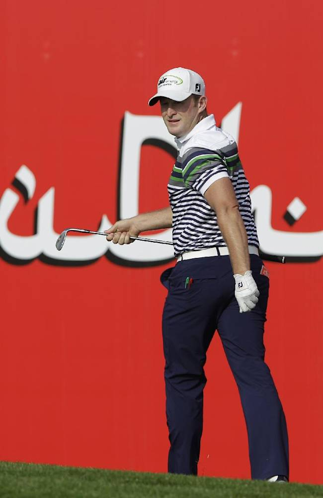Jamie Donaldson of Wales practices a shot on the 18th hole during the 1st round of the Abu Dhabi HSBC Golf Championship in Abu Dhabi, United Arab Emirates, Thursday, Jan. 16, 2014