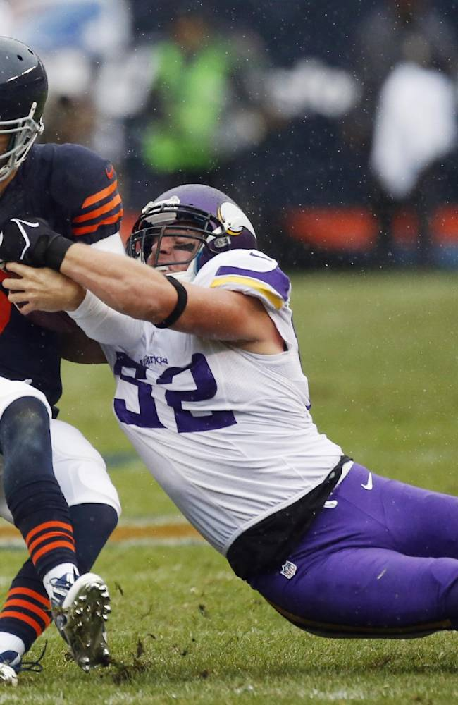 Chicago Bears quarterback Jay Cutler (6) is tackled by Minnesota Vikings defensive end George Johnson (92) during the first half of an NFL football game on Sunday, Sept. 15, 2013, in Chicago