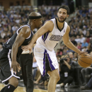 Sacramento Kings guard Greivis Vasquez, of Venezuela, right, dribbles against Brooklyn Nets guard Jason Terry during the fourth quarter of an NBA basketball game in Sacramento, Calif., Wednesday, Nov. 13, 2013. The Kings won 107-86 The Associated Press
