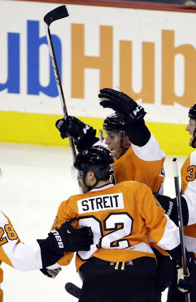 Philadelphia Flyers' Claude Giroux, from left, Mark Streit, of Switzerland, Vincent Lecavalier and Jay Rosehill celebrate after Lecavalier's goal during the third period of an NHL hockey game against the Buffalo Sabres, Thursday, Nov. 21, 2013, in Philadelphia. Philadelphia won 4-1
