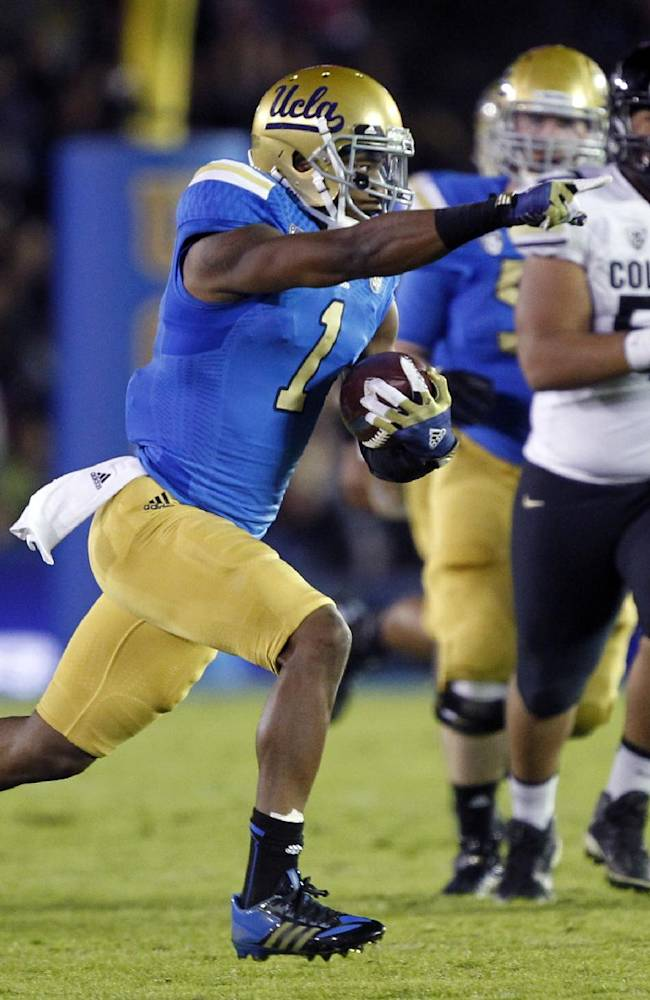 UCLA wide receiver Shaquelle Evans (1) points to teammates to set up blocking on a 36-yard run after a catch against Colorado in the second half of their NCAA college football game Saturday, Nov. 2, 2013, in Pasadena, Calif. UCLA won the game 45-23