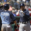 Tampa Bay Rays' James Loney, right, is welcomed home by David DeJesus, left, after Loney hit a two-run home run, allowing DeJesus to score, in the second inning of an exhibition baseball game against the Boston Red Sox, Tuesday, March 4, 2014, in Fort Mye