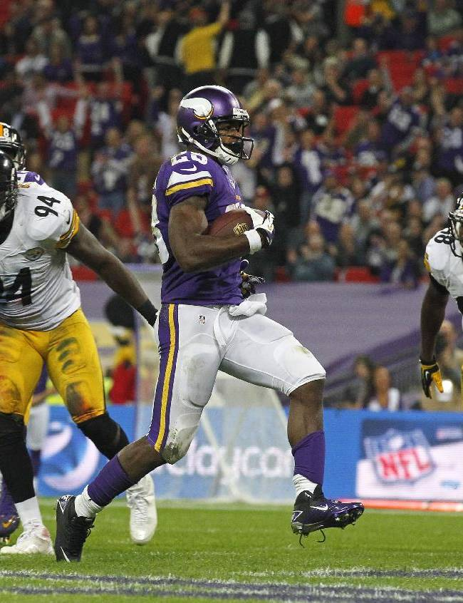 Minnesota Vikings running back Adrian Peterson (28), centre, strolls over to score a 3rd quarter touchdown during the NFL football game against Pittsburgh Steelers at Wembley Stadium, London, Sunday, Sept. 29, 2013