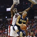 California-Irvine's Alex Young (1) attempts a reverse layup against UNLV's Quintrell Thomas in the first half of an NCAA college basketball game, Wednesday, Nov. 28, 2012, in Las Vegas. (AP Photo/Julie Jacobson)