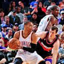 PHOENIX, AZ - FEBRUARY 10: Russell Westbrook #0 of the Oklahoma City Thunder drives against Goran Dragic #1 of the Phoenix Suns on February 10, 2013 at U.S. Airways Center in Phoenix, Arizona. (Photo by Barry Gossage/NBAE via Getty Images)