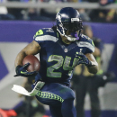 Seattle Seahawks running back Marshawn Lynch (24) rushes during the second half of NFL Super Bowl XLIX football game against the New England Patriots Sunday, Feb. 1, 2015, in Glendale, Ariz. (AP Photo/Mark Humphrey)