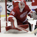 Detroit Red Wings goalie Jimmy Howard (35) makes a save during the third period of an NHL hockey game against the Los Angeles Kings, Friday, Oct. 31, 2014, in Detroit. The Red Wings defeated the Kings 5-2 The Associated Press