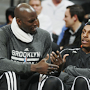 Brooklyn Nets forwards Kevin Garnett, left, and Paul Pierce confer while on the bench as the Nets face the Denver Nuggets in the third quarter of the Nets' 112-89 victory in an NBA basketball game in Denver on Thursday, Feb. 27, 2014. (AP Photo/David Zalubowski)