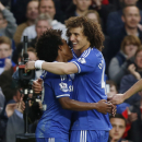 Chelsea's Willian, left, celebrates his goal against Stoke City with teammate David Luiz during their English Premier League soccer match at Stamford Bridge, London, Saturday, April 5, 2014