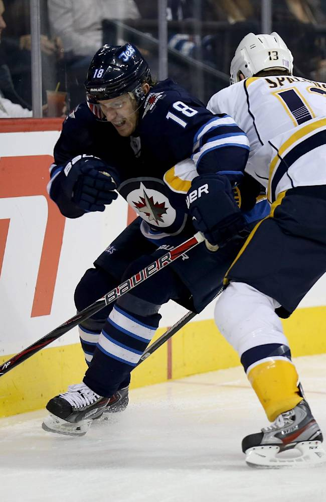Winnipeg Jets' Bryan Little (18) is hit into the boards by Nashville Predators' Nick Spaling (13) during second period NHL hockey action in Winnipeg, Sunday, Oct. 20, 2013