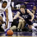 Washington's C.J. Wilcox, left, and Western Washington's Austin Bragg vie for a loose ball in the first half of an exhibition NCAA college basketball game, Wednesday, Oct. 24, 2012, in Seattle. (AP Photo/Elaine Thompson)
