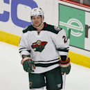 Minnesota Wild left wing Matt Cooke (24) looks on after scoring against the Chicago Blackhawks during the third period of an NHL hockey game in Chicago, Sunday, Jan. 11, 2015. The Blackhawks won 4-1 The Associated Press
