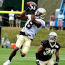 New Orleans Saints wide receiver Charles Hawkins (18) catches the ball over defensive back Trevin Wade (30) during NFL football training camp in White Sulphur Springs, W. Va., Sunday, July 27, 2014 The Associated Press