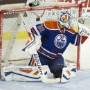 Edmonton Oilers goalie Richard Bachman fails to stop the shot by Chicago Blackhawks Duncan Keith during second period NHL pre-season action in Saskatoon, Saskatchewan, Sunday, Sept 28, 2014. The Associated Press