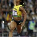 Jamaica's Shelly-Ann Fraser-Pryce goes to cross the finish line to win gold in the women's 100-meter final during the athletics in the Olympic Stadium at the 2012 Summer Olympics, London, Saturday, Aug. 4, 2012. (AP Photo/Anja Niedringhaus)