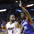 Miami Heat guard Dwyane Wade (3) looks for an opening past Philadelphia 76ers center Henry Sims (35) during the first half of an NBA basketball game on Wednesday, April 16, 2014, in Miami The Associated Press