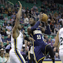 Indiana Pacers' Roy Hibbert (55) shoots as Utah Jazz's Derrick Favors, left, defends in the first quarter during an NBA basketball game Wednesday, Dec. 4, 2013, in Salt Lake City The Associated Press