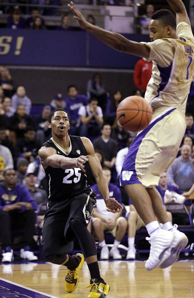 Colorado's Spencer Dinwiddie (25) puts a baseline pass by Washington's Darin Johnson in the first half of an NCAA men's basketball game Sunday, Jan. 12, 2014, in Seattle