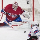 Montreal Canadiens goaltender Carey Price makes a save against New York Rangers' Mats Zuccarello during the first period of an NHL hockey game Saturday, Oct. 25, 2014, in Montreal The Associated Press