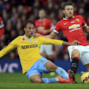 Crystal Palace's Marouane Chamakh and Manchester United's Michael Carrick, right, battle for the ball during their English Premier League match at Old Trafford, Manchester England Saturday Nov. 8, 2014
