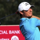 Chris Wood of England plays his shot on the 18th hole during the third round of the Commercial Bank Qatar Masters held at the Doha Golf Club in Qatar, Friday, Jan. 25, 2013. (AP Photo/Osama Faisal)