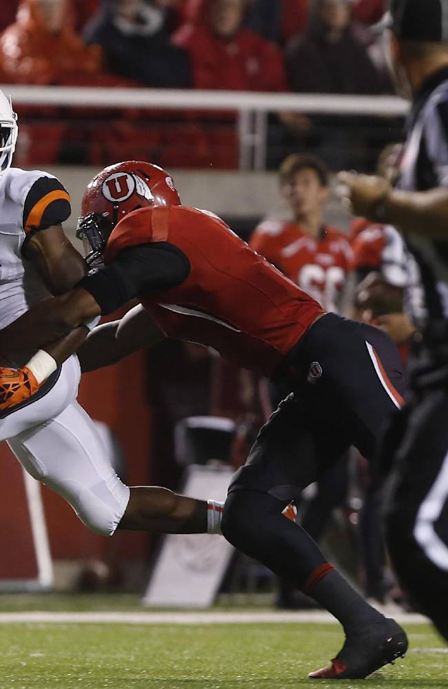 Oregon State wide receiver Brandin Cooks (7) is tackled by Utah defensive back Keith McGill (1) in the second quarter during an NCAA college football game in Salt Lake City, Utah, Saturday, Sept. 14, 2013
