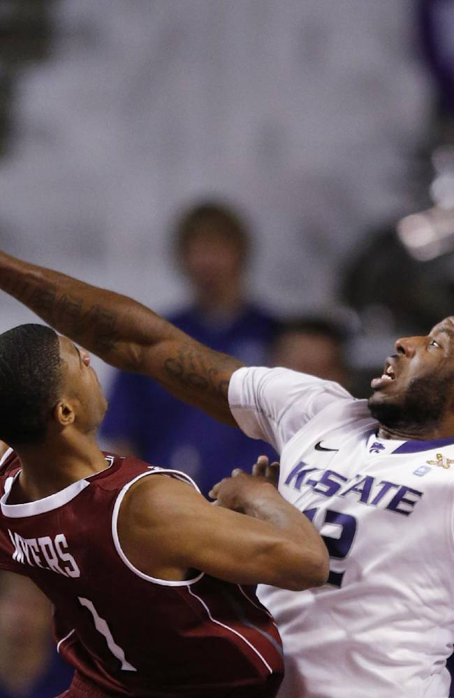 Kansas State forward Thomas Gipson (42) fouls Troy guard Antoine Myers (1) during the second half of an NCAA college basketball game at Bramlage Coliseum in Manhattan, Kan., Sunday, Dec. 15, 2013. Kansas State defeated Troy 72-43
