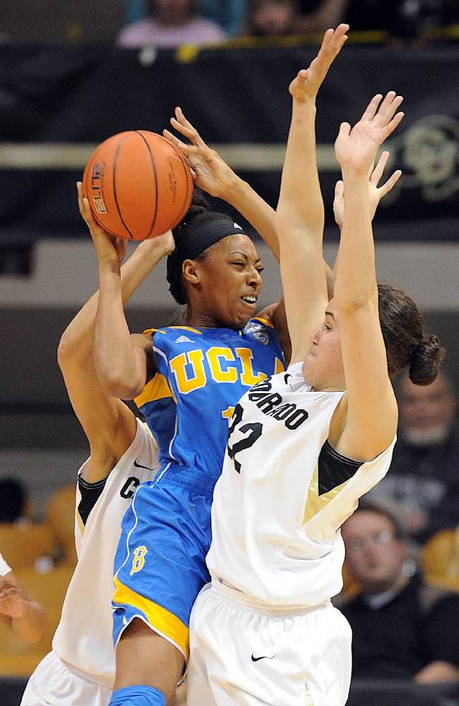 UCLA's Atonye Nyingifa tries to pass around Colorado's Haley Smith during the first half of an NCAA college basketball game Friday, Feb. 28, 2014, in Boulder, Colo