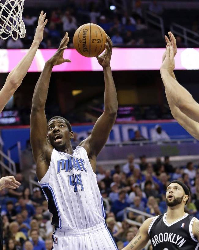 Orlando Magic's Andrew Nicholson (44) makes a shot as he gets between Brooklyn Nets' Andrei Kirilenko (47), of Russia, Deron Williams, second from right and Brook Lopez during the second half of an NBA basketball game in Orlando, Fla., Sunday, Nov. 3, 2013. Orlando Magic won 107-86
