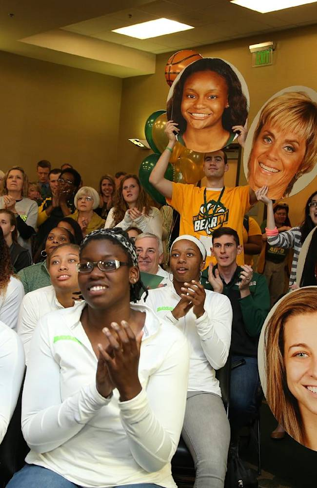 Baylor guard Odyssey Sims (0), left and center Sune Agbuke (22), right, applaud during during the NCAA selection process, Monday, March 17, 2014, in Waco, Texas