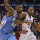 Toronto Raptors' Kyle Lowry, right, drives at Denver Nuggets' Darrell Arthur during the second half of an NBA basketball game on Sunday, Dec. 1, 2013, in Toronto The Associated Press