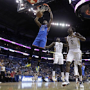 Oklahoma City Thunder small forward Kevin Durant (35) slam dunks over New Orleans Pelicans small forward Al-Farouq Aminu (0), shooting guard Anthony Morrow (3) and power forward Ryan Anderson, left, in the second half of an NBA basketball game in New Orl