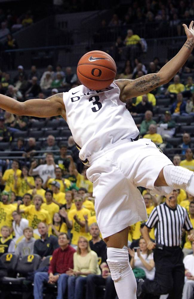 Oregon guard Joseph Young scores on a breakaway during the first half of an NCAA college basketball game against Utah Valley in Eugene, Ore., Tuesday, Nov. 19, 2013