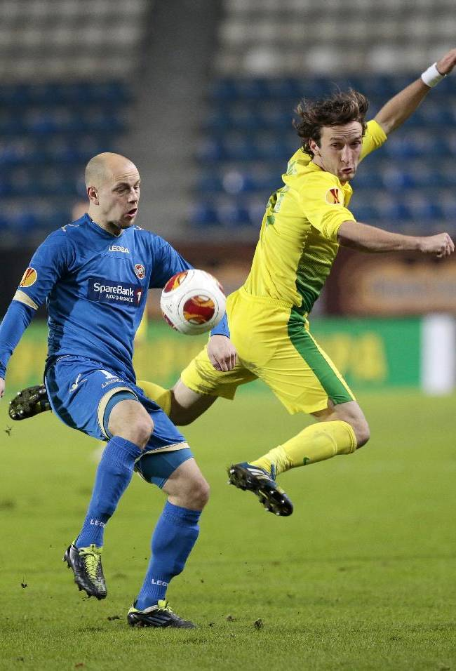 Tromso's Hans Norbye, left, and Anzhi's Alan Gatagov fight for the ball during the Europa League group K soccer match between Anzhi Makhachkala and Tromso IL at Saturn stadium in Ramenskoye, outside Moscow, in Russia, on Thursday, Oct. 24, 2013