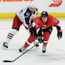 Ottawa Senators' Zack Smith fights to keep the puck from Columbus Blue Jackets' Mark Letestu during second period NHL hockey action in Ottawa, Ontario, on Saturday, Oct. 18, 2014. (AP Photo/The Canadian Press, Sean Kilpatrick)