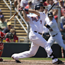 Minnesota Twins' Joe Mauer hits an RBI single off Boston Red Sox pitcher Allen Webster as Red Sox catcher A.J. Pierzynski, left, looks on in the first inning of an exhibition baseball game, Saturday, March 1, 2014, in Fort Myers, Fla The Associated Press