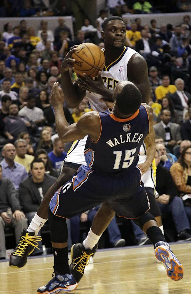 Indiana Pacers guard Lance Stephenson, top, commits an offensive foul on Charlotte Bobcats guard Kemba Walker (15) during the second half of an NBA basketball game in Indianapolis, Friday, Dec. 13, 2013. The Pacers won 99-94