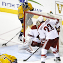 Nashville Predators forward Patric Hornqvist (27), of Sweden, scores against Phoenix Coyotes goalie Thomas Greiss, of Germany, as Oliver Ekman-Larsson (23), of Sweden, also defends in the third period of an NHL hockey game on Thursday, April 10, 2014, in